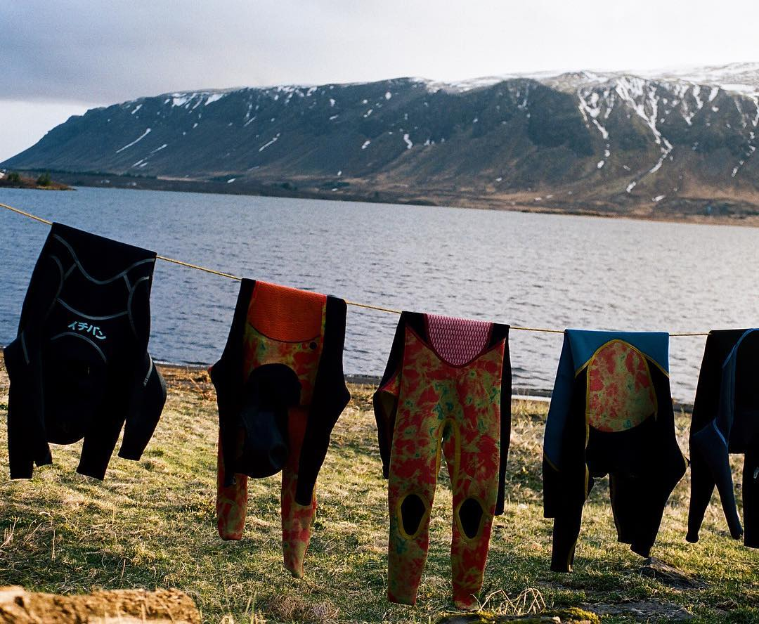 Wetsuits drying in the elusive Icelandic sunshine