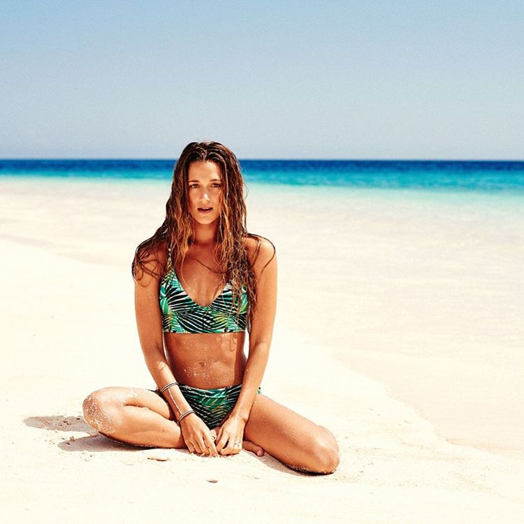 @monycaeleogram taking time out on the tide line in the Jungle Fever Bikini