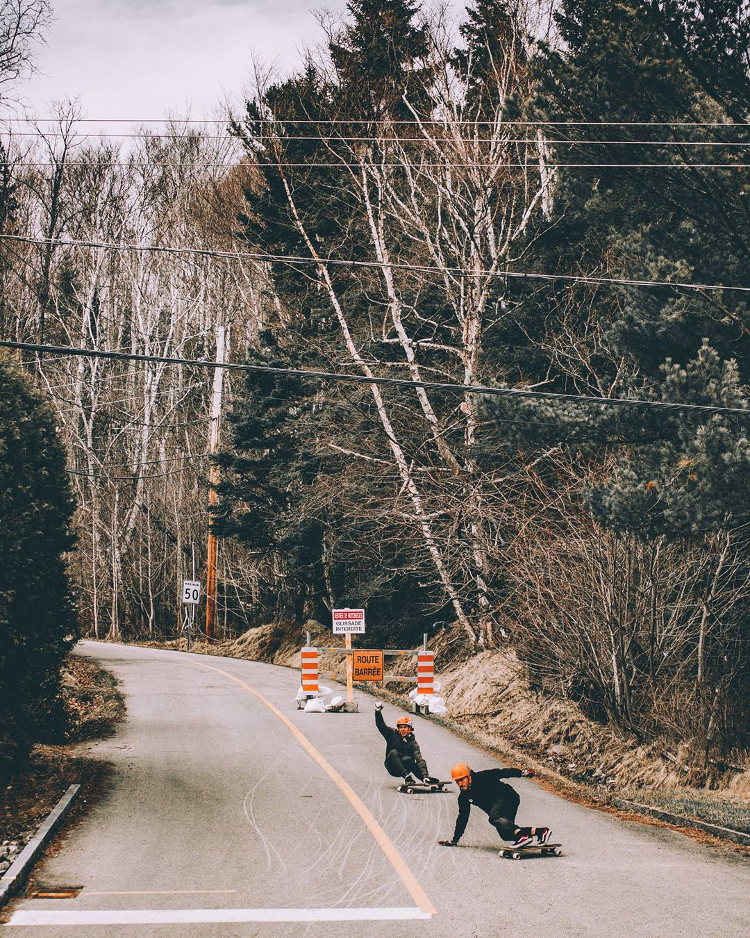 This road is so steep that it's close in the winter.  Team riders @lp_dery and @charlesouimet took advantage of the early season and shred both 20% hairpins.  #restlessboards #restlesswim #restlessfishbowl