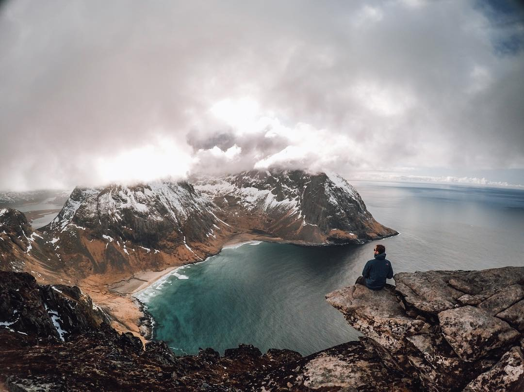 Photo of the Day! @stevejenness enjoys the best seat in the house, overlooking the #LofotenIslands in #Norway