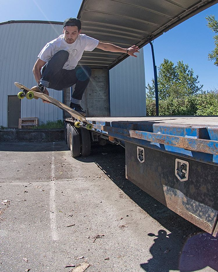 Ian Hilger (@pizzashrapnel_) with an early grab out of an old semi-truck behind the DB Longboards shop on the Compound CoreFlex.