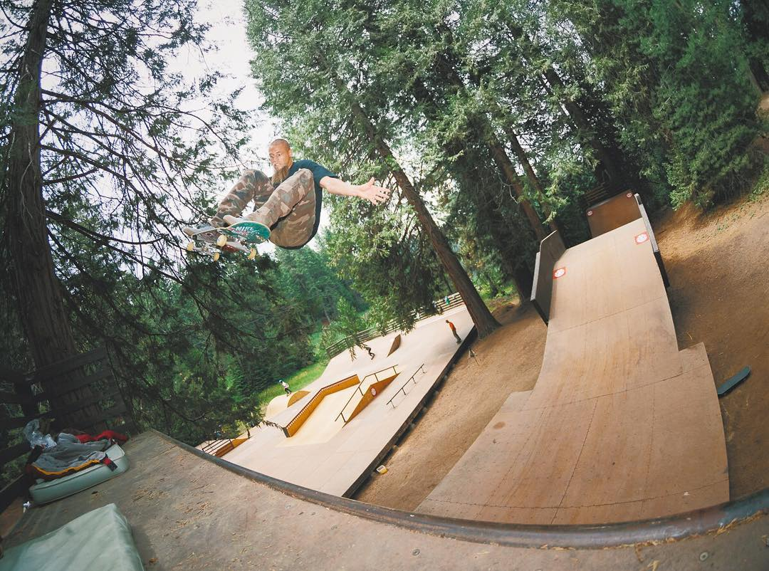 After waking up underneath the sequoias at @elementskatecamp @greyson_fletcher blasted a huge frontside air for breakfast on the mini mega >>> Sign up for skate camp today to have epic times like this over the summer! >>>