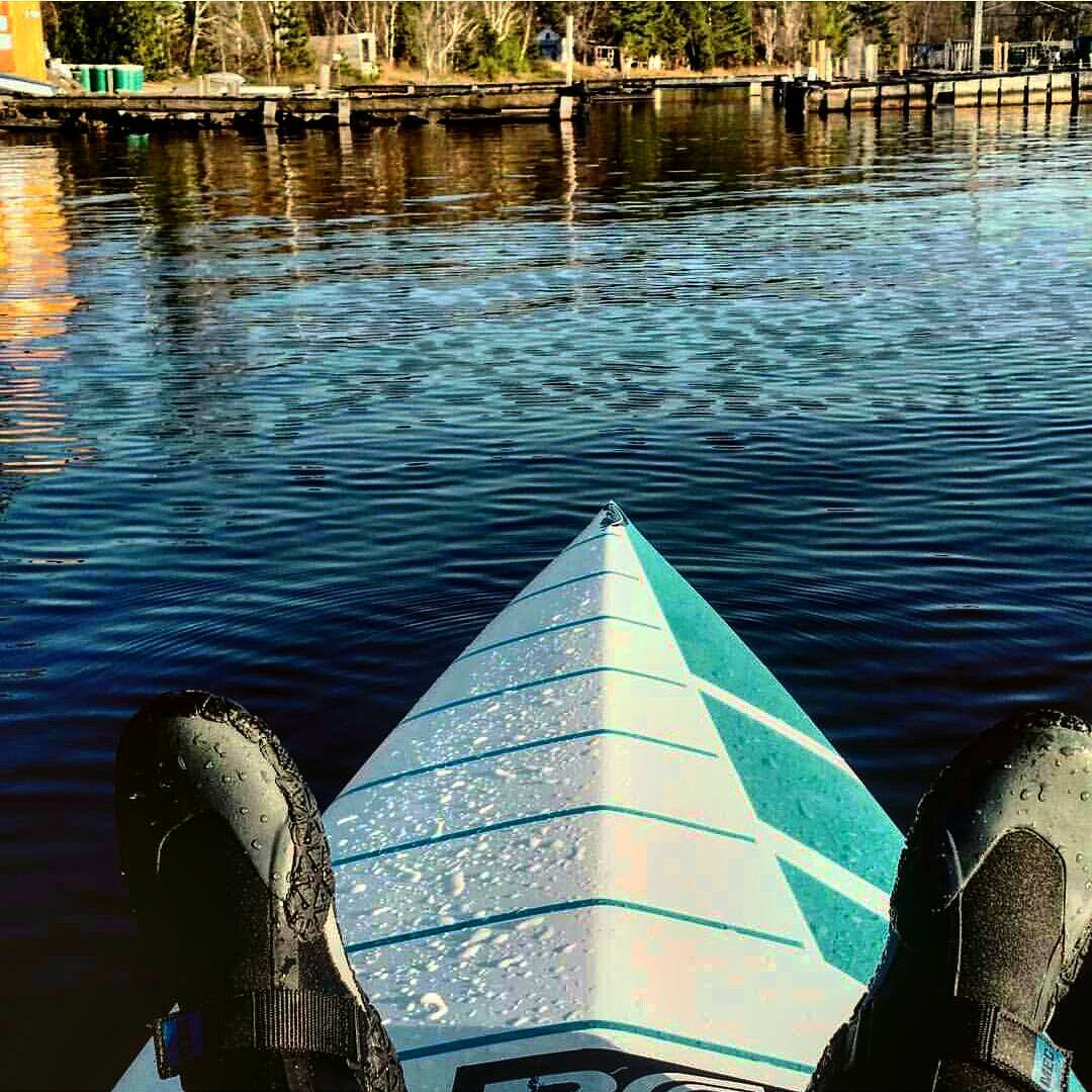 @Fisher_N_Hunter warming up her feet after a nice training session in Canada.  #playhardpaddleharder #sup #canada #springishere