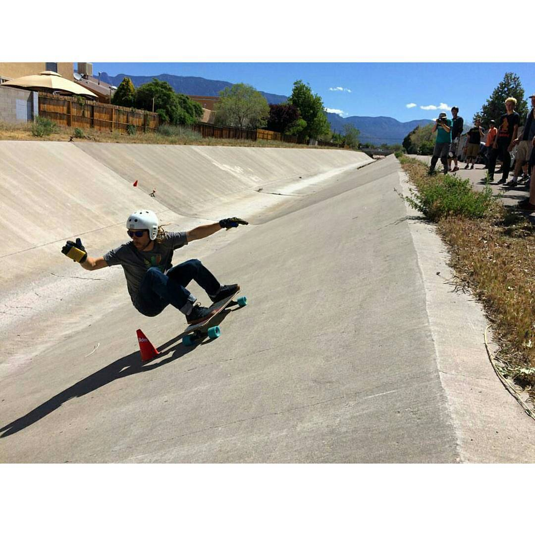 #SLAP is happening now in a high elevation land of never-ending concrete snake runs. @williamroyce lays out a high-speed carve on the Slalom course. @muirskate photo. #willroyce also rides #bustinboards #fiveOwheels #gullwingtrucks and #muirskate