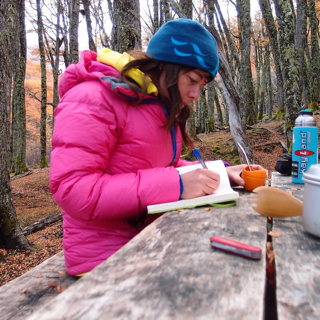 ASC Scat #adventurescientist Karin Mullendorff jots down some notes among the fall colors in the #CerroCastillo National Reserve. She collected scat samples while #backpacking on #Patagonia's #Horquetastrail.  Going backpacking soon? It's easy to get...