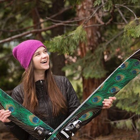 @tahoetatum poses for her senior photos with the skis she loves most