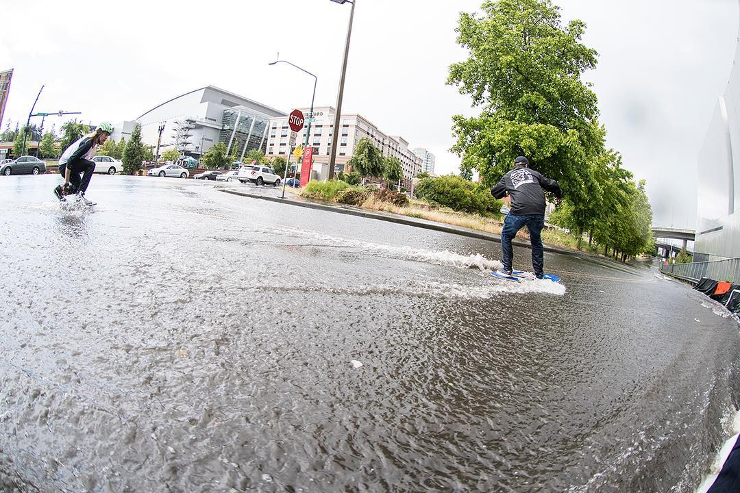 Last weekend at Alchemy Skateboarding's Go Skate Tacoma day the streets flooded. Naturally @achilles180 decided to skate down it with @equalmotion leading the way on a skimboard. Click the link in our bio for more photos and video. #dblongboards...