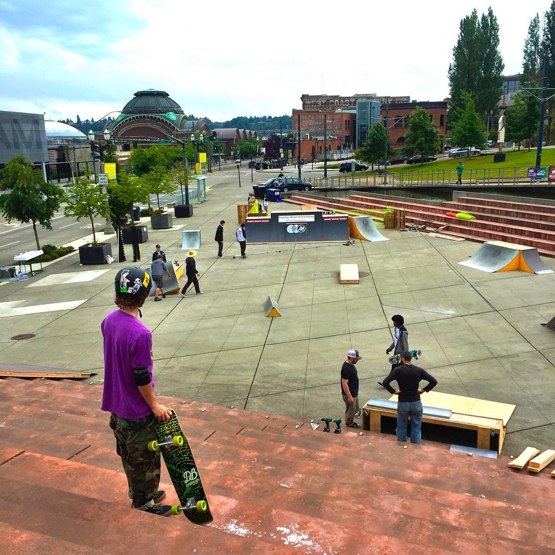 Devon Dotson checking out the setup at Tollefson Plaza for @alchemy_skateboarding's Go Skate Day Tacoma! Come out and skate with us! #goskateday #dblongboards #goskate #goskatedaytacoma #goskatetacoma2016