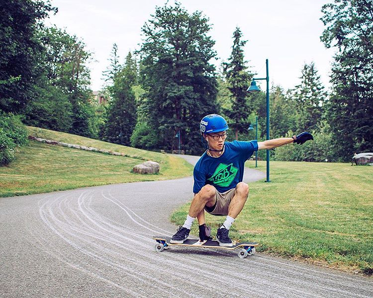 Bill Kim (@nwnatives) with a fresh slide on the Contra. Rad photo by @samgalus. #dbcontra #dblongboards #pnw #longboard #downhillskateboarding