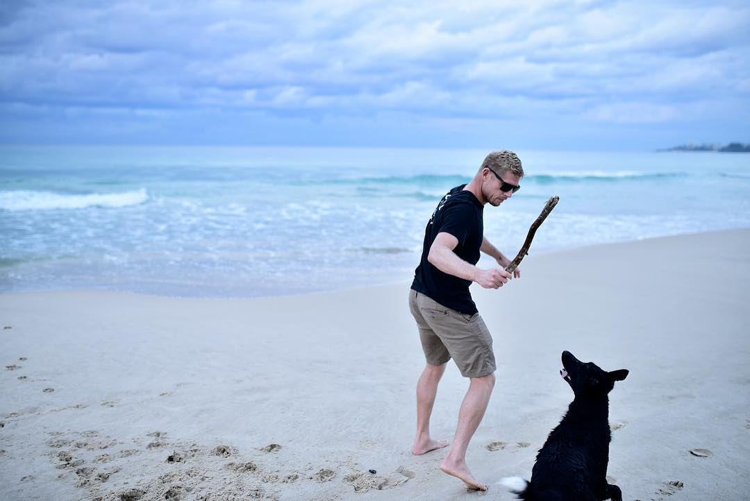 A man and his best friend, plus an ocean. @trent_mitchell_ #dragonsunglasses #monarch