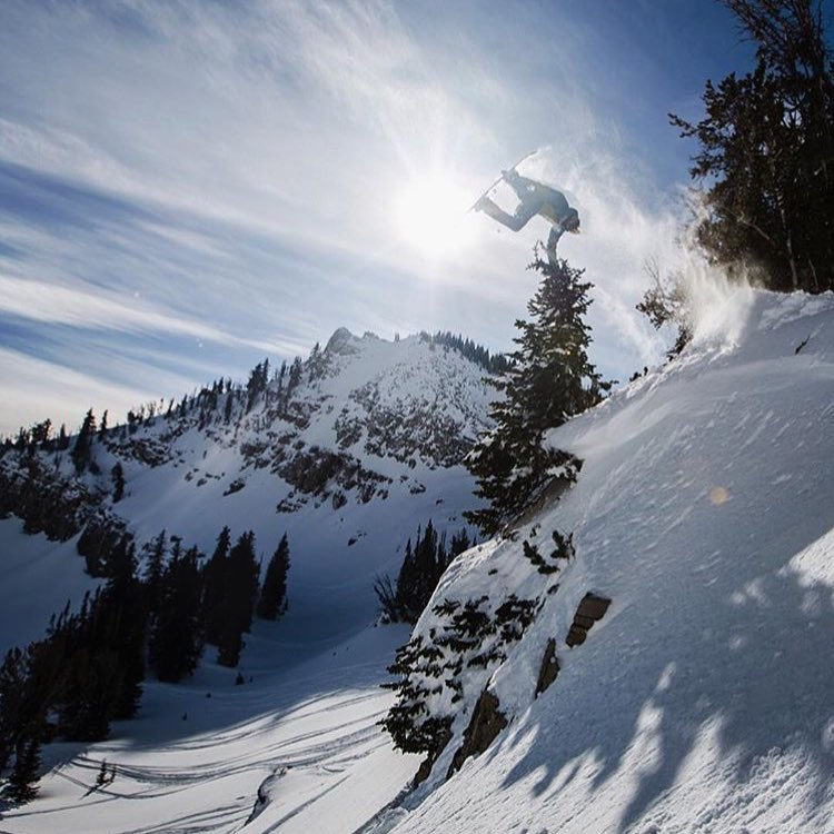 @blakepaul with a tree hand drag off a cliff step down this past winter in Jackson, WY.
