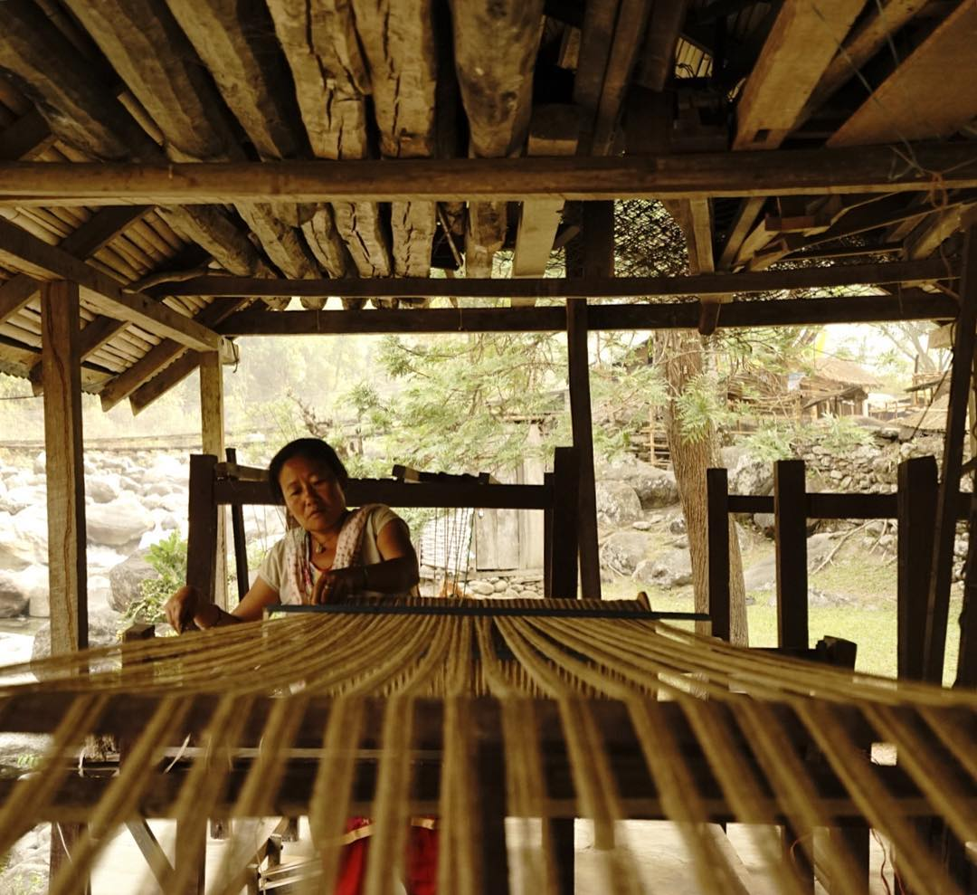 Anjh Kumari prepping spools of nettle for the loom. Our Himalayan nettle is harvested in the jungles around the village before its processed, spun and woven into the textile used in many of our products. The entire process is done without any...