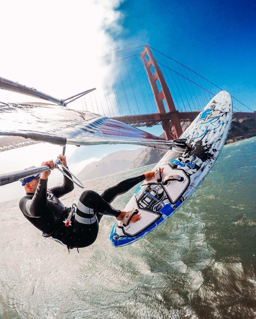 "Photo of the Day! Ian Boyd knows when the fog rolls in on the #GoldenGateBridge, the conditions are ripe for some #windsurfing! As he says, ""it's the best #happyhour in the city."" #GoPro #SanFrancisco #GoldenGate #KarltheFog #SurfSF #SF #"
