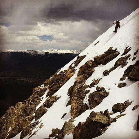 DROPPING!! MHM shredder @instasteney finding some of the last lines of winter...er, summer. Here he be on Buffalo Peak. #MHMgear #PacksElevated