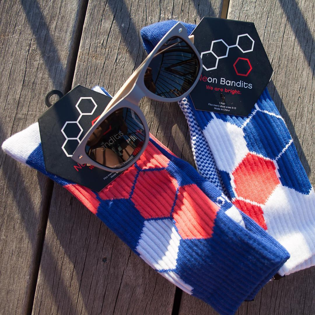 #giveawaytime any followers of @neonbandits and @surreal_sunglasses who tags 3 friends is entered to #win a pair of Neon Bandits #socks and Surreal sunglasses #swag #summer #sunsout