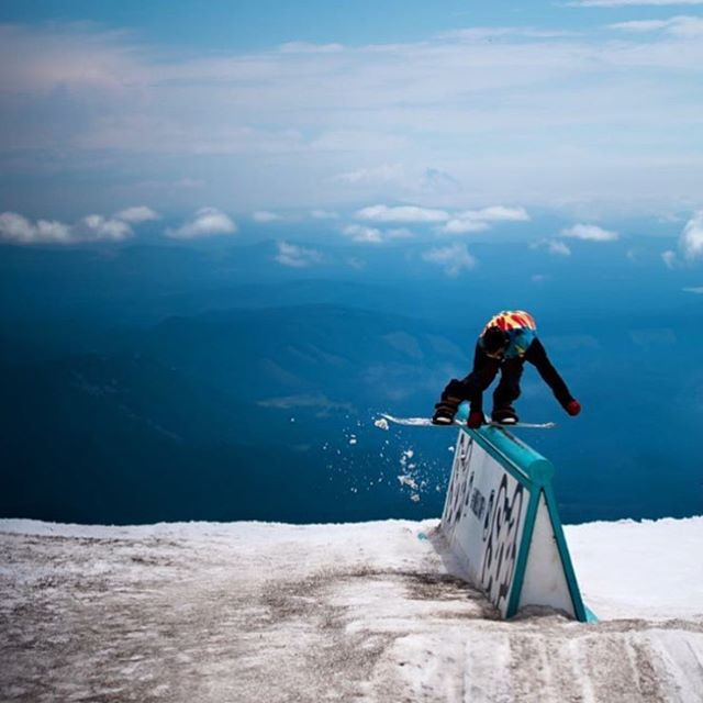 #NYNEtribe member @buzzholbrook doing yoga in the mountains. #LifeSoundsGood #summertime? #snowboarding