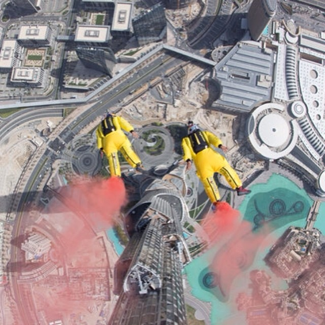 Headed straight into the record books! Fred Fugen and Vincent Reffet soar 828m off the world's tallest building, Dubai's Burj Khalifa.