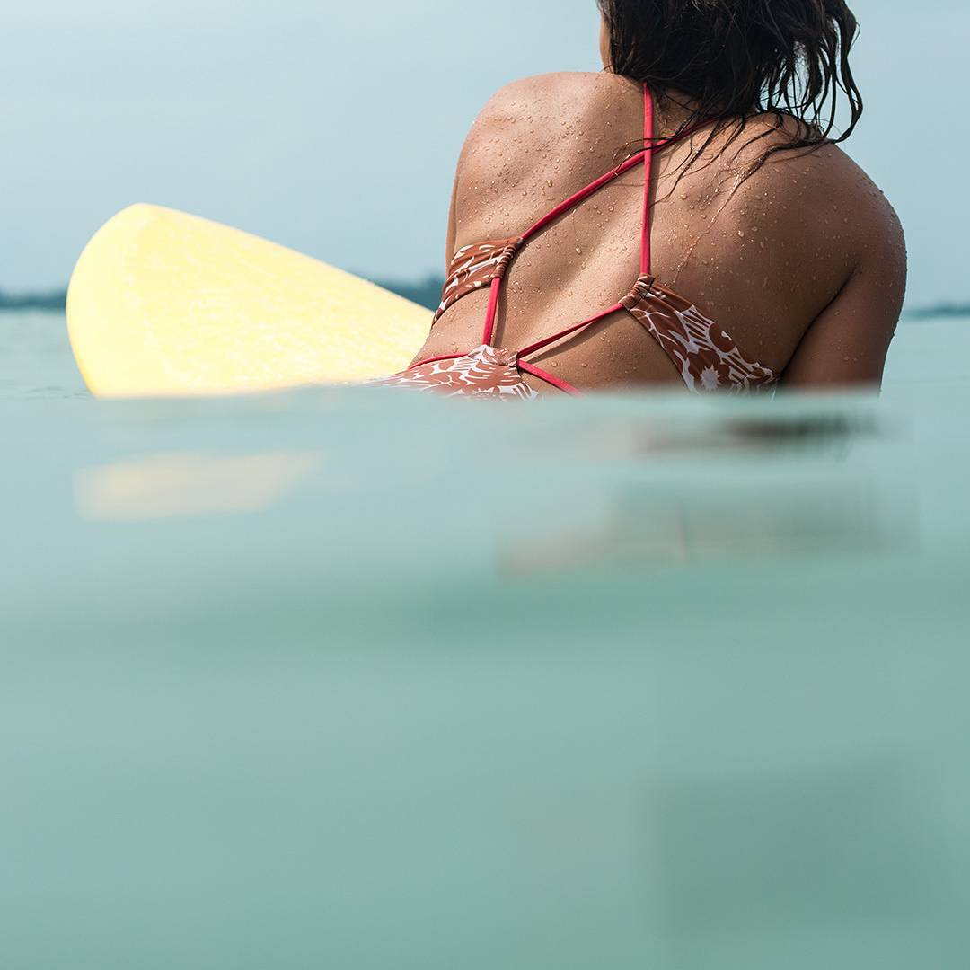 Tropical warm waters are surfers' ideal playgrounds.  @Mele_Saili enjoys a break between sets in Panama wearing the #seeaanglet shot by @Nick_Lavecchia #myseealife #welovewarmwater #Seeababes #Seeainpanama
