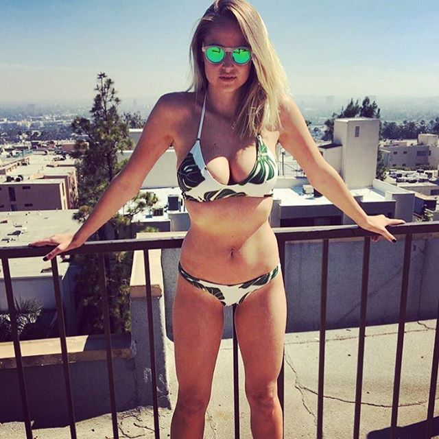 Sports Illustrated #swimsuit #model @genevievemorton looks stunning in her #Waveborn #sunglasses and @greenleeswim #bikini that both support good causes #givesight #findthesun