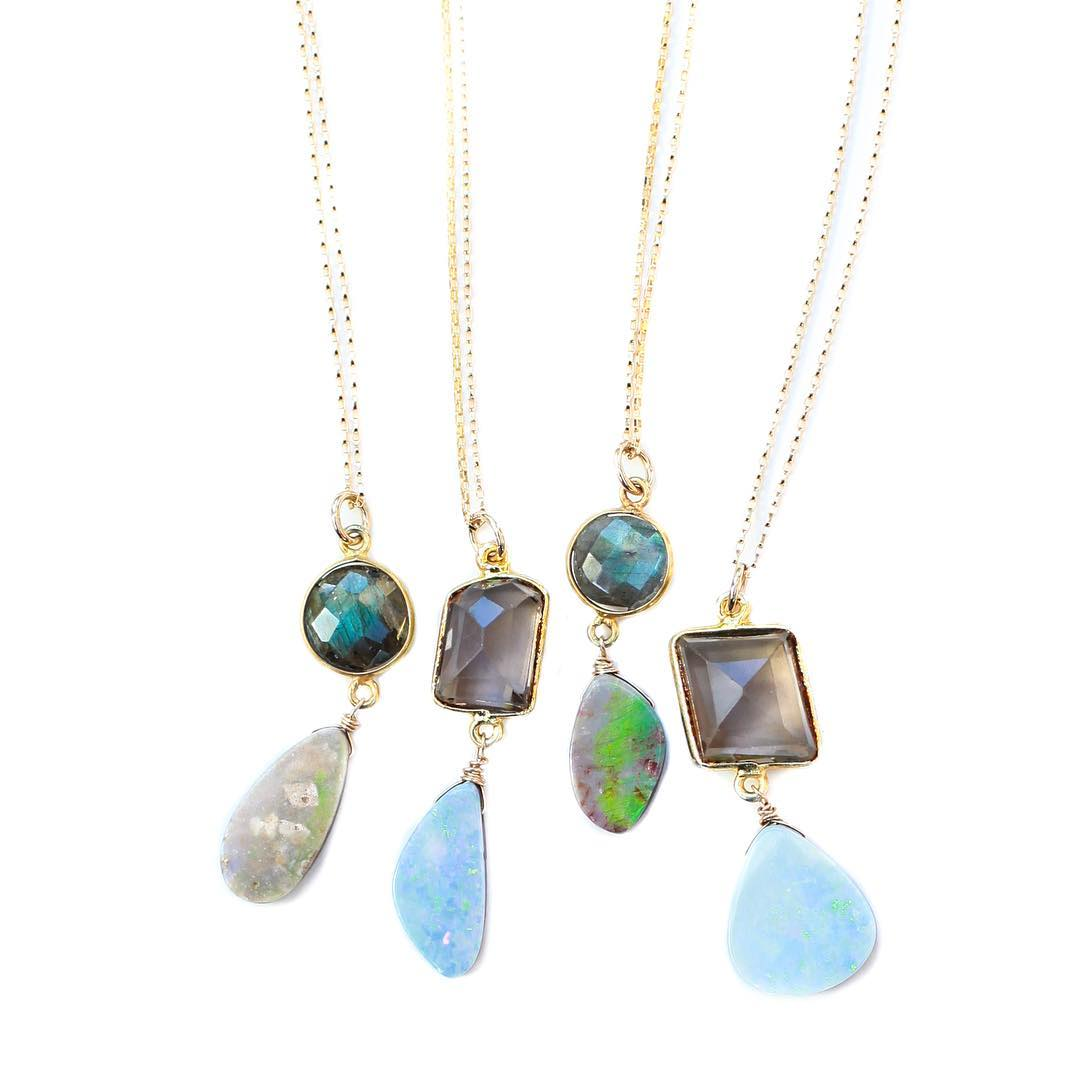 Opal pendants paired with Labradorite and Smokey Quartz! Limited editions in the one-of-kind shop!  #opals #opaljourney #juliaszendrei #boulderopal #opal #opaljewelry #crystalhealing #crystalgypsy #green #blue #somethingblue #gemlove