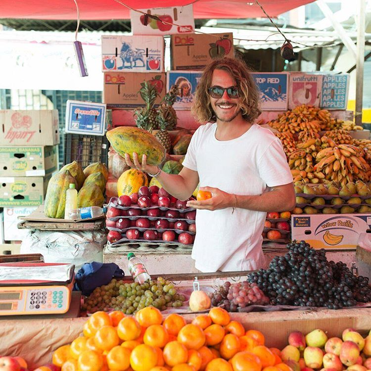 Speaking Spanish in the market amid the hustle and bustle of Talara, Max buys some fruit to make juice for the morning's breakfast.  @ryanstruck takeover 8/9