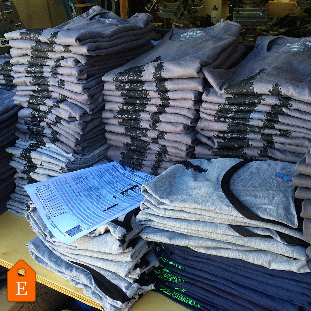 Tshirts for days. Getting organized at the shop. #risedesigns #risedesignstahoe #riseshop #tshirts #yosemitetree