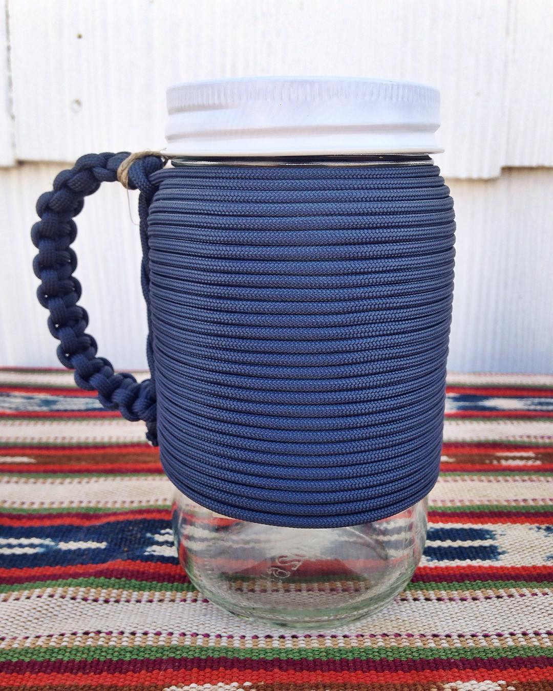~ Adventure Mug ~  We're restocked on the reusable Adventure Mug in both moss green and navy blue.  Fill it up and hit the road. The screw on cap ensures no leaks while it rolls around the floor of your rig. The sturdy, hand wrapped paracord handle...