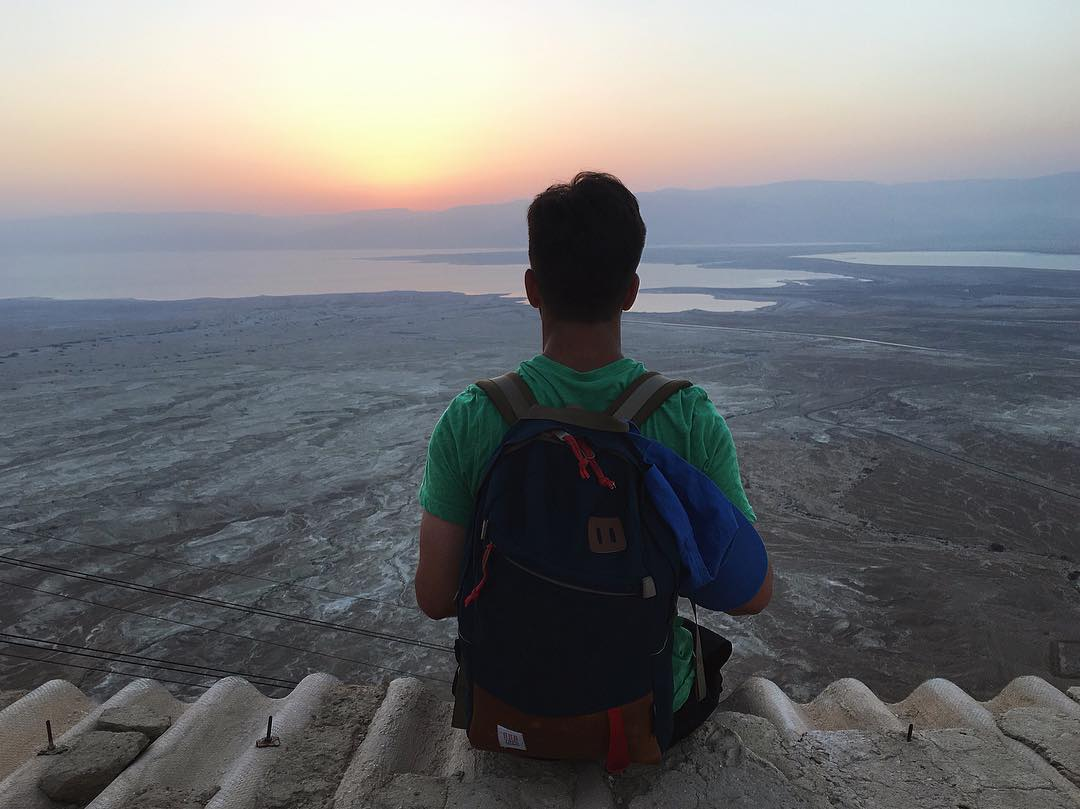 sunrise cliff hangs above the dead sea