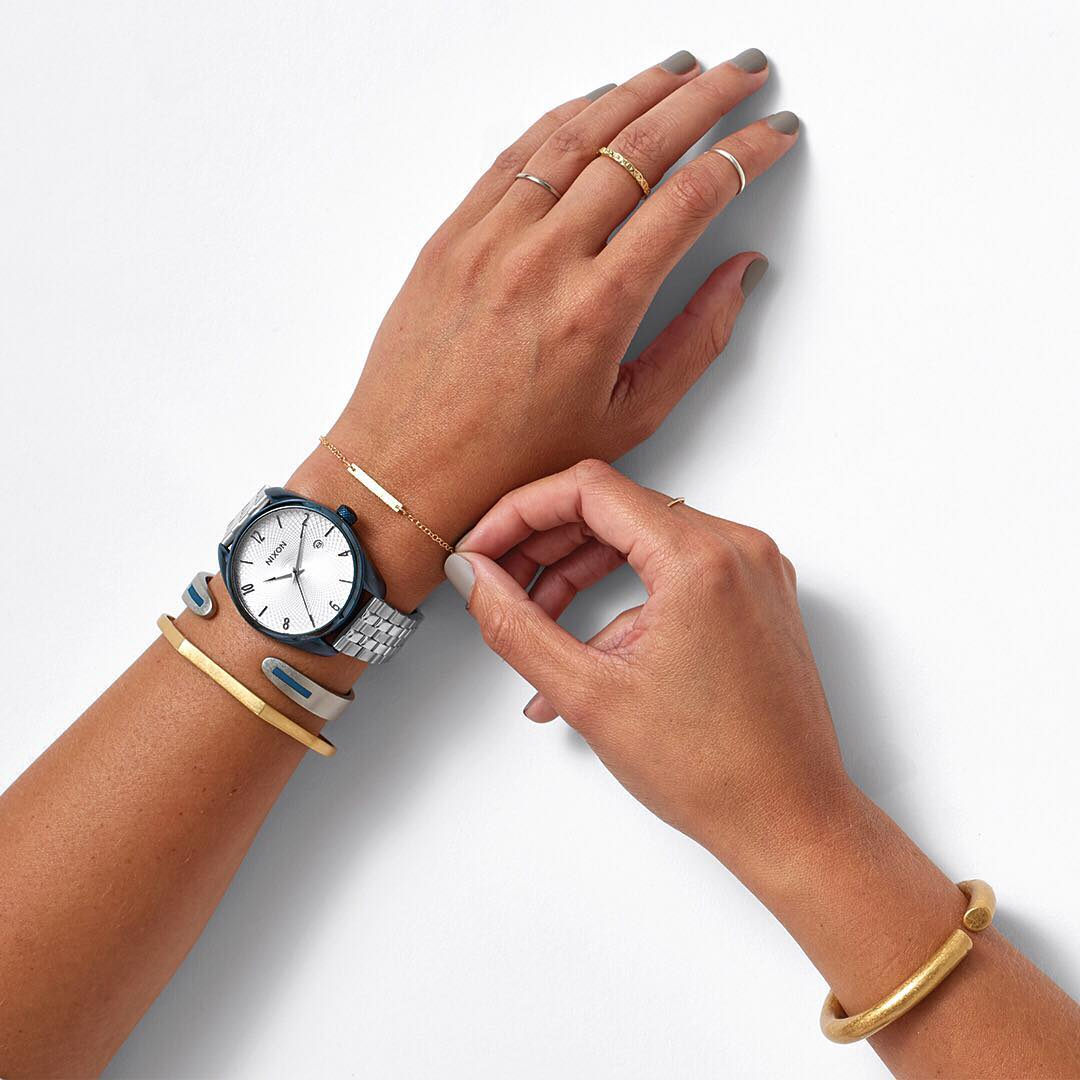 Go nautical. Brushed silver and deep navy make the Nixon #MixedMessages Collection a fresh take on the classic nautical look.