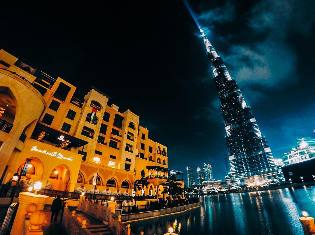 Photo of the Day! The #BurjKhalifa towers over the souq al bahar in #Dubai. The #BurjKhalifa stands over 800 meters high, making it the tallest structure in the world!  #