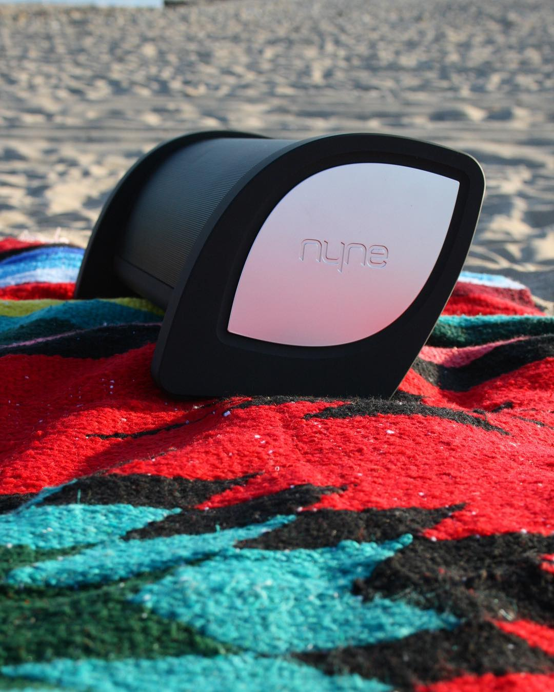 Attention all beach bums: don't get up - just turn it up. #NYNEbass #lifesoundsgood #summer #beachbum #bluetoothaudio #beachday #summermusic