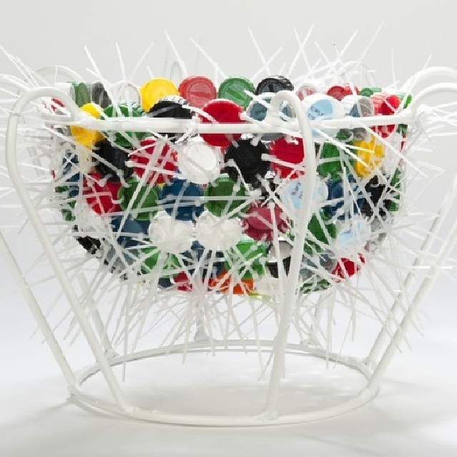 An  array  of  colorful  repurposed  soda  bottle  caps  are  attached  together  using  zip  ties  to  a  powder  coated  steel  form.  The  bowl's  steel  structure  is  composed  of  98%  recycled  steel  content,  finished  with  an ...