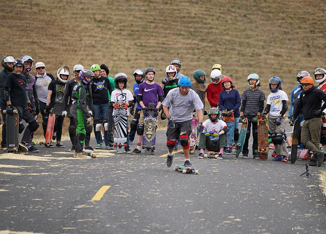 A few weeks back Joe Lehm from @skateschoolsantafe led a race camp at Maryhill Loops Road. Here he kicks into the hill on his #ParisSavants while the rest of the campers look on. #paristrucks