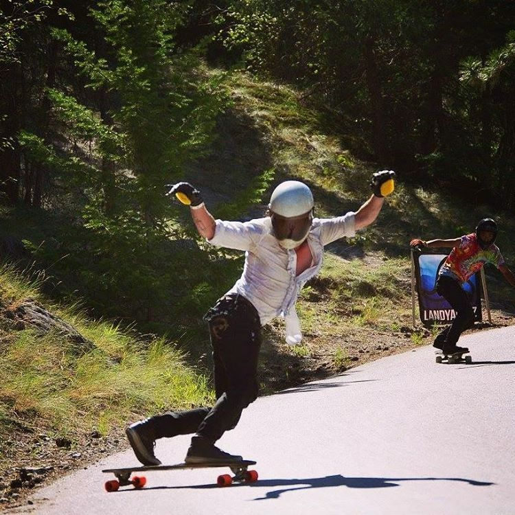 Stefan Kaiter-Snyder holding out a fat toeside at Giants Head riding the MC Cat board!