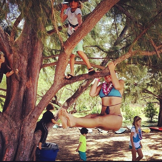 Our girls know how to have fun! Legendary big wave surfer Jam Starr and her son Waimea swinging from the trees in Maui!