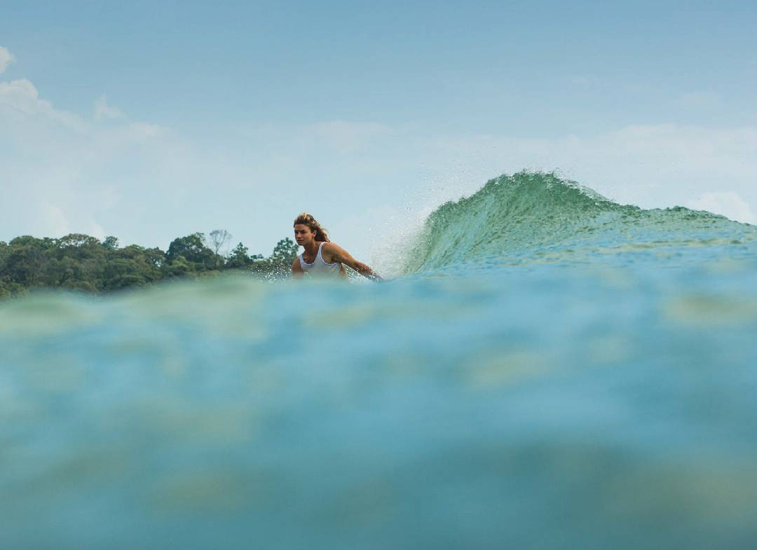 """I love to connect to the wave by putting a hand in the water.  It helps to keep me in the pocket, and it also gives me a giddy feeling of becoming a part of the wave,"" remarks @leahloves.  Here she is, slowing down in Panama, wearing the..."