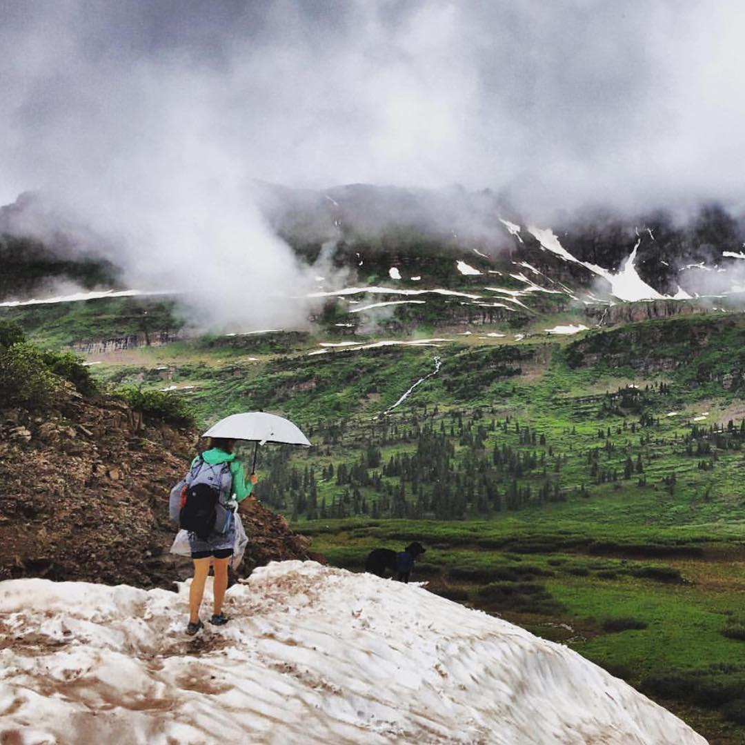 @sbrook13 taking a walk in the rain. #iamsj #SheJumps #Colorado #hiking #getoutthere #umbrella #backpacking