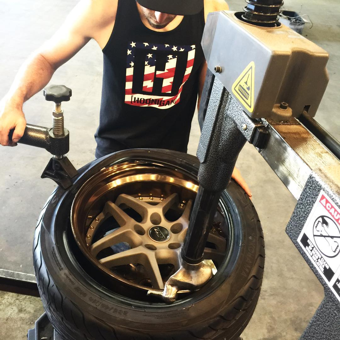 Letting our dude @willroegge(co-creator of #KeepDriftingFun) use the #DonutGarage tire machine to mount some fresh rubber on his new johnnies. Lookin' good!