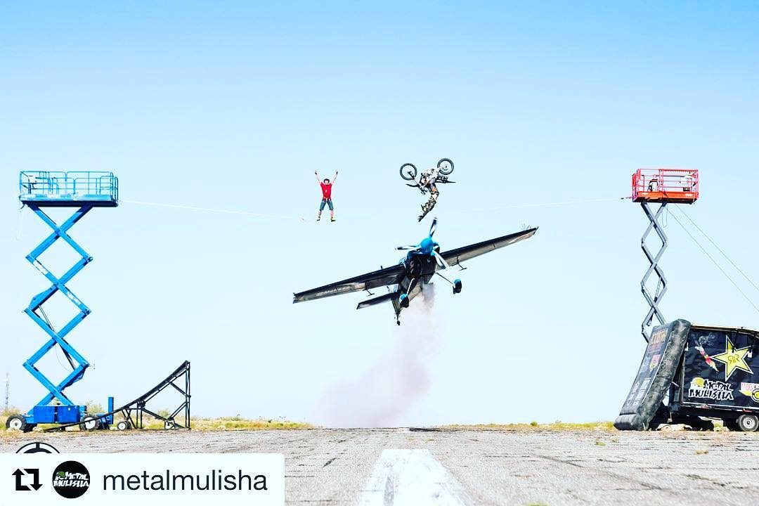 Check out @jfitzo doing a #backflip over a #airplane #stunt while some #sketchy dude does a tight rope on @metalmulisha then click bio