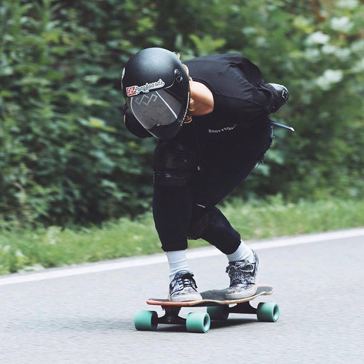 Rosanne Steeneken tucking on the Keystone at Wallonhill in Houyet, Belgium. (Photo by Holger Schnepp)  #dblongboards #dbkeystone #downhillskateboarding #longboard #summer