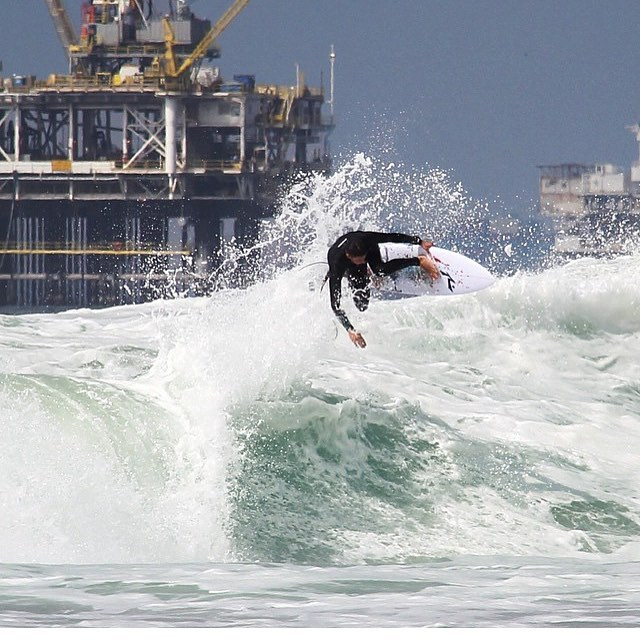 Our buddy @nick_molde boosting the oil rigs in Huntington Beach, CA.