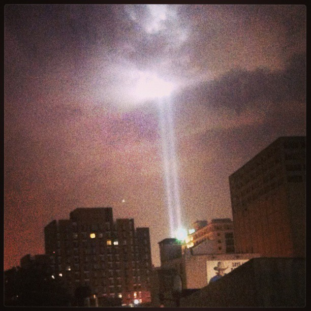 Freedom tower light reach the clouds in tribute