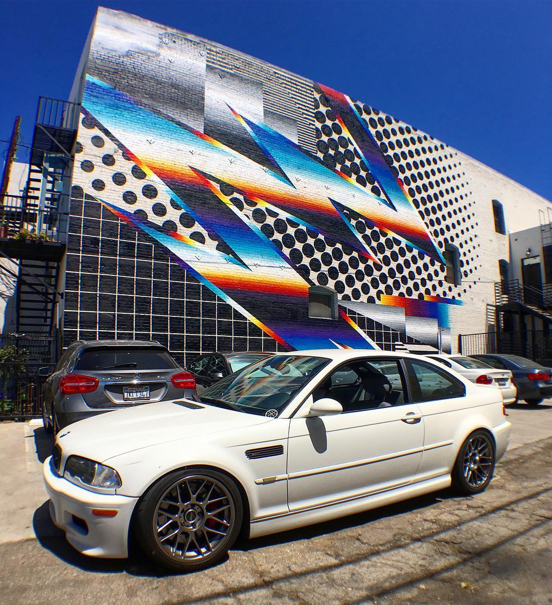 Our buddy @felipepantone left his mark on Down Town Long Beach, so took @vin_tra's M3 down to check it out! Tap the link in our bio for our entire line up inspired / designed by Pantone! #HooniganDOTcom #felipepantone #pantone #m3 #e46m3 #art #streetart