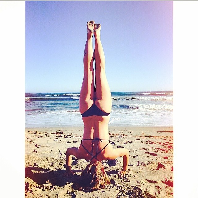 @yotorieee #enjoying a #morning #yoga #practice to #start her day off right! In the #Bands of #love #twopiece #bikini #comingsoon #beach #handstand #bikini #sun