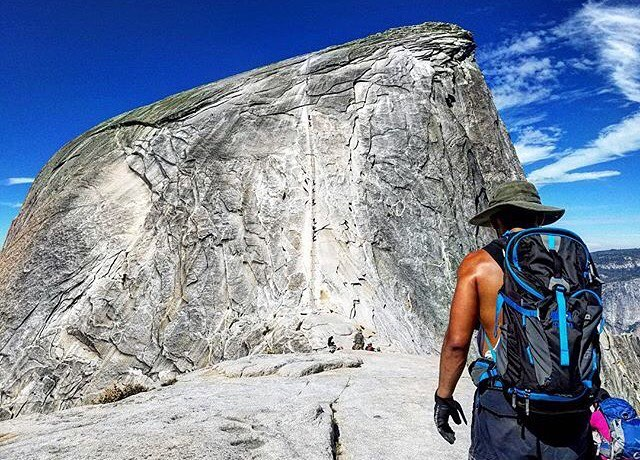Half Dome. 50% as good as Full Dome. @anth0ny_0313 Salute-ing his way toward the former. #MHMgear #PacksElevated #AdventureCapitalists