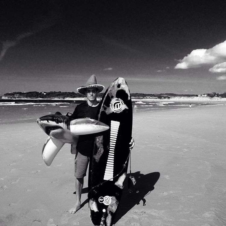A lost surfer found walking the beaches in search of himself with a #surfboard inflatable #shark and #stoke. #wavetribe