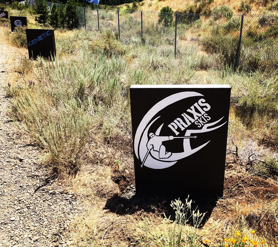 Proud sponsor tombstone at the Truckee Bike Park on the return road! #praxisskis #twoplanks #twowheels #summershredding #truckeebikepark #brownpow