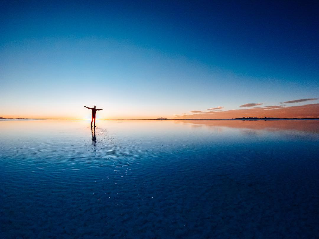 Photo of the Day! Taking in the breathtaking expanse of #SalarDeUyuni, the largest salt flat in the world. #