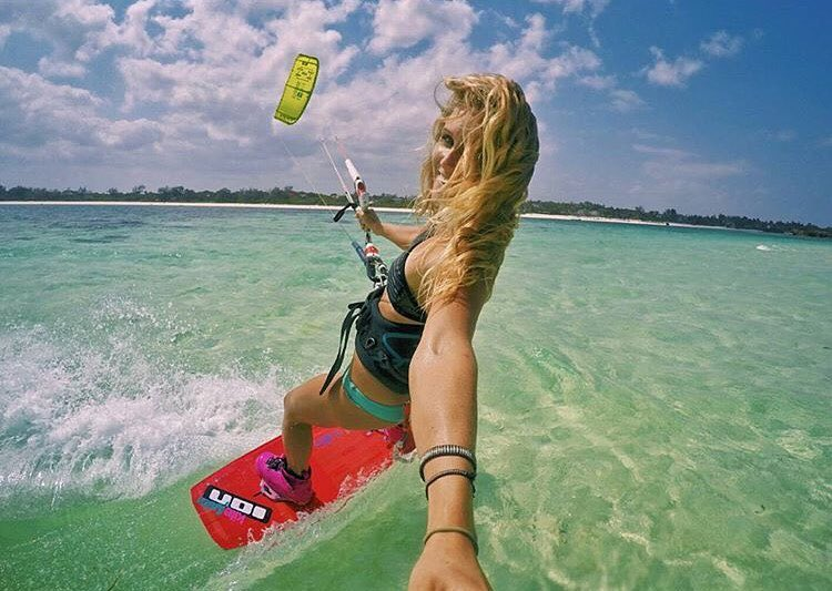 It may not be warm enough this summer to ride in the #pnw in a bikini, but that doesn't stop me from dreaming about it. Love, love this beautiful shot of @colleenjcarroll finding her bliss in Africa. #kitesista #kitesurfing #kiteboarding #kite and