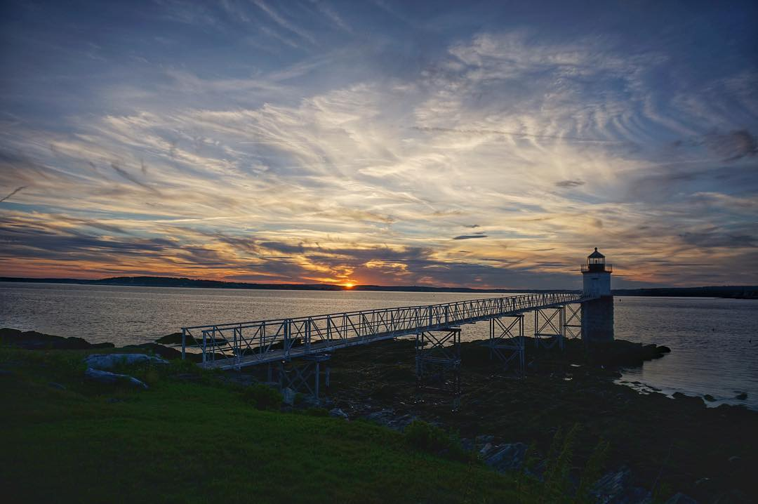 It was a quintessential Maine evening!  Pictured here Ram Island light with the sun setting over Southport Island! #boothbayharbor #sonya6000 #ramisland #sunsetpics #sunset #optoutside #lighthouse #maine #mainetheway